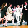 """Peru Central High School students Megan Sears (Morticia) and Ross Coughlin as Gomez (both in black) rehearse a scene for the Peru Drama Club's upcoming performance of """"The Addams Family,"""" which will take place this Thursday through Saturday at 7:30 p.m., along with an extra showing at 2 p.m. Saturday in the school auditorium.<br><br>(GABE DICKENS/P-R PHOTO)"""