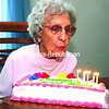Helen Spear, who turned 102 on Monday, blows out candles on her birthday cake during a family celebration in Keeseville. She was born on March 2, 1913, and married her husband, Fred, on Feb. 20, 1932. They were together for 51 years. She has six kids and 29 grandchildren. Helen worked as a cook for more than 40 years at Physicians Hospital and SUNY Plattsburgh. Her hobbies are gardening, playing cards, bird watching and dancing. When asked about her secret to a long life, she said no smoking or drinking.<br><br>(ROB FOUNTAIN/STAFF PHOTO)