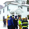 Firefighters and state fire investigators gather outside the home at 58 Bouck St. in Dannemora, where on Thursday, Alan H. Breyette, 66, died of smoke inhalation in a fire. The blaze broke out in the kitchen of one of the duplexes shortly before 4 a.m. Three other residents were taken to University of Vermont Health Network, CVPH Medical Center as a precautionary measure.<br><br>(GABE DICKENS/P-R PHOTO)
