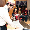 Rabbi Avrohom Rimler reads the Megillah, which contains the biblical narrative of the book of Esther, during a Purim festival Thursday evening at the Chabad of Plattsburgh.<br><br>(GABE DICKENS/P-R PHOTO)