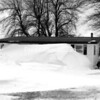 A seasonal home on Point au Fer Road in the Town of Champlain is all but obscured by a massive snowdrift. This easternmost part of the point is exposed to strong south winds, which deposit large amounts of snow on the leeward side of this dwelling and the one next to it.  <br><br>(DAN HEATH/STAFF PHOTO)