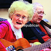 Priscilla Chesnut is accompanied by 94-year-old resident Roger Baker as they do a weekly performance at the Essex Center for Rehabilitation and Healthcare in Elizabethtown.<br><br>(ALVIN REINER/P-R PHOTO)