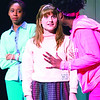 """SUNY Plattsburgh students Jychaelle Bogard (from right), playing Margie, Caitlin Krahn as Keera and Marlie Jeanlus, portraying Annie, rehearse a scene from the play """"Milk Like Sugar"""" in the college's Hartman Theatre on Wednesday evening. In the play, Annie and her friends make a pact on her 16th birthday that forces her to question the world around her in a story that combines hope, poetry and wit. Showtimes are today and Saturday at 7:30 p.m. and Sunday at 2 p.m.<br><br>(GABE DICKENS/P-R PHOTO)"""