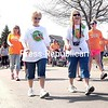 Walkers head out for the start of the Walk MS at the U.S. Oval on Sunday in Plattsburgh. The event raised funds for the National Multiple Sclerosis Society and also included a wellness fair, auction, food, kids activities and more.<br><br>(ROB FOUNTAIN/STAFF PHOTO)