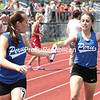 Peru's Taylor Canet hands off the baton to teammate Rachel Sheldrick during the girls' 1,600 relay Saturday. The Indians won the relay.<br /> <br /> (GABE DICKENS/P-R PHOTO)