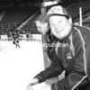 Gold-medal Olympian Mike Eruzione smiles as players take the ice during the recent Miracle on Ice Fantasy Camp in Lake Placid. More than 50 Olympic hockey wannabes shelled out more than $5,500 each to rub elbows, pass the puck and break bread with real members of the 1980 team of legend. Participants in the four-day experience wore replica uniforms of the gold-medal team and played several scrimmages on the same ice where the U.S. team defeated the powerful Russian squad in 1980.<br><br>(JACK LADUKE/P-R PHOTO)