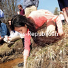 Seton Catholic seventh-grader Sophie Von Bargen releases salmon fry into the Saranac River in Plattsburgh. The science class received salmon eggs in mid January from the Lake Clear Fish Hatchery through a grant from Trout Unlimited. Students raised them and did a salmon eco-system study. They released 130 young salmon into the river.<br><br>(ROB FOUNTAIN/STAFF PHOTO)