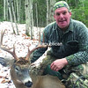Drew Hanchett of Schroon Lake poses with a 9-pointer taken last fall, one of many from that area.<br><br>(DAN LADD/P-R PHOTO)