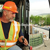 Monty Santa Maria operates an excavator on the Route 86 bridge in Wilmington with a rearview look at the newly paved roadway. The new span was set to open today, after 90 days of construction.<br /> <br /> (JACK LADUKE/P-R PHOTO)