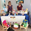 JCEO Development Specialist Kathy Bishop (left) and Sara Arnold, a Community Action Angel, are selling raffle tickets to raise money for the agency's Backpack Program, which feeds 90 children in Plattsburgh.