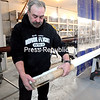 Adirondack Flagpoles owner Danny Kaifetz compares the 100-year-old sample of a flagpole he has been asked to re-create for the Veterans Hospital in Alameda, Calif. The two end sections, manufactured to match the original, took longer than the rest of the flagpole.<br /> <br /> (ROB FOUNTAIN/STAFF PHOTO)
