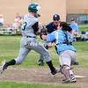 Westport catcher Briar Christian tries to tag out Chazy runner Austin Gravelle, but misses during a Mountain and Valley Athletic Conference baseball game in Chazy Monday.<br><br>(ROB FOUNTAIN/STAFF PHOTO)