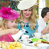 """Maeve Moser, 6, of Chazy pours some milk into her tea while being accompanied by her aunt Heidi Moser of Middletown at a tea held recently at Chazy Presbyterian Church Social Hall. The event featured a """"Downton Abbey"""" theme with door prizes, best-hat contest, basket raffles and more. Proceeds benefit the Chazy Presbyterian Women's local mission projects.<br /> <br /> (GABE DICKENS/P-R PHOTO)"""