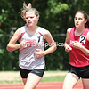 Beekmantown's Kirsten Villemaire (left) and Amy LoTemplio race around the track during the girls' 3,000. Villemaire won that event and three others.<br /> <br /> (GABE DICKENS/P-R PHOTO)