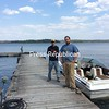 Nathan Smart (left) and Kyle King of Champlain Boatworks at Snug Harbor Marina were able to help members of the South Plattsburgh Fire Department rescue two kayakers who had capsized Monday morning on their way to Valcour Island. Two people were transported to the hospital for evaluation and treatment of symptoms of hypothermia.<br><br>(DAN HEATH/STAFF PHOTO)