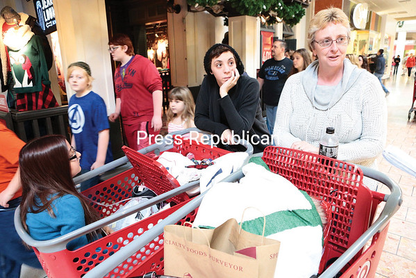 Anna Lincoln, joined by her daughters Elizabeth McCray and Gabby Lincoln (left), talks about their Black Friday shopping experience at the Champlain Centre mall Friday afternoon in Plattsburgh. (GABE DICKENS/P-R PHOTO)