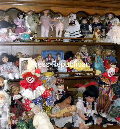 Grace probably has 500 dolls in various places throughout her home, like this china buffet in her dining room. (Susan Tobias/Staff Photo)