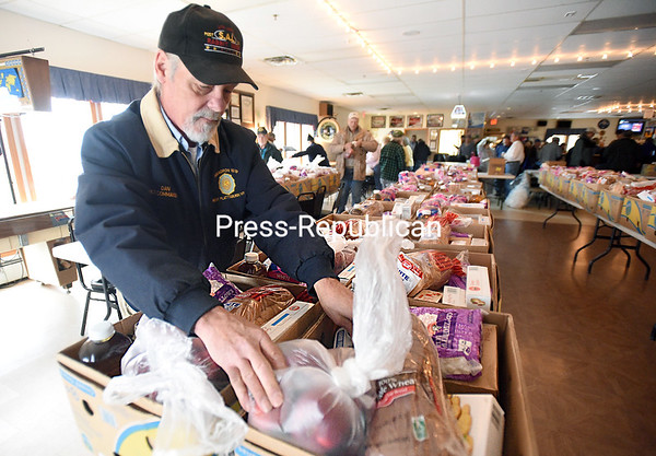 Dan Easton, chaplain for American Legion Post 1619 in Morrisonville, packs Thanksgiving baskets for area veterans. Eighty food baskets will be given to local veterans in Clinton County. The Sons of the American Legion coordinates the baskets with help from the Legion, Ladies Auxiliary and the Legion Riders. (ROB FOUNTAIN/STAFF PHOTO)