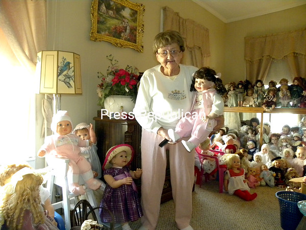 Grace Rule has collected more than 2,000 dolls in her lifetime. She has many favorites but she likes this one especially because it seems to be lifelike. (Susan Tobias/Staff Photo)