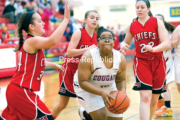 Northeastern Clinton's Valerie Simmons pump-fakes before going for a layup while Saranac's Skye O'Connell defends during the championship match of the Muggsy's Tip-Off Classic at Saranac Central School Saturday afternoon. (GABE DICKENS/P-R PHOTO)