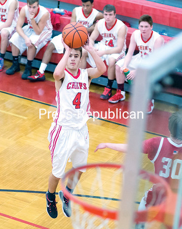 Saranac's Brian Menia goes up for the jump shot during Friday's game against Schroon Lake in the Muggsy's Tip-Off Classic basketball tournament at Saranac Central School. (Gabe Dickens/P-R Photo)