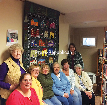 Lake Shore Scrappers (from left) Kay Kern, Michelle Gruetzmacher, Linda LaFountain, Velma Peryea, Mary Lou Beauharnois, Jean Arlt, Tina Parikh and Jean Welch. (ROBIN CAUDELL/STAFF PHOTO)