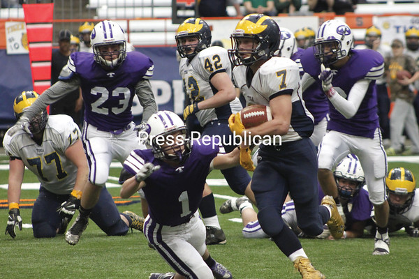 Tioga running back Jesse Manuel carries the ball past Ticonderoga's Cody Huestis for a touchdown during the second quarter of Friday's NYSPHSAA Class D state championship game held at the Carrier Dome in Syracuse. (COURTNEY LEWIS/STAFF PHOTO)