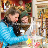 Plattsburgh resident Deena Giltz McCullough and her daughter, Megan, who now lives in Boulder, Colo., browse the jewelry selection at Mid-Century Mad Vintage Variety on Brinkerhoff Street in Plattsburgh during Small Business Saturday. Local businesses that were involved in the event offered discounts to entice customers into their stores similar to what happens on Black Friday. (GABE DICKENS/P-R PHOTO)