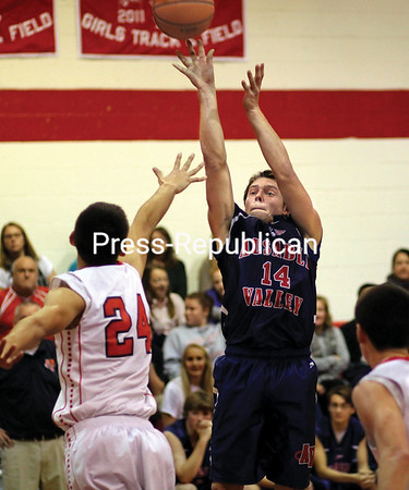 Moriah's Adam Jaquish (24) steps out to defend a shot by AuSable Valley's Kobe Parrow during Sunday's championship game of the 5th Annual Alzheimer's Awareness Tournament at Moriah Central School. (ALVIN REINER/P-R Photo)