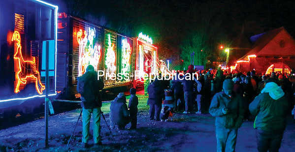 A crowd estimated at 3,000 people showed up for the arrival of the Canadian Pacific Holiday Train in Port Henry. Village Mayor Ernest Guerin said 98.9 WOKO, a Vermont-based radio station, promoted the train's visit for three days and came to do a live remote broadcast. (LOHR McKINSTRY/STAFF PHOTO)