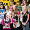 """Middle and high school girls representing every school in Clinton County take part in the Champlain Valley Sweet Adelines' Young Women in Harmony Workshop, where they learned to sing in four-part harmony and acapella. Among the songs they performed at the Plattsburgh High School auditorium were """"One Fine Day"""" and """"Mr. Sandman."""" (GABE DICKENS/P-R PHOTO)"""