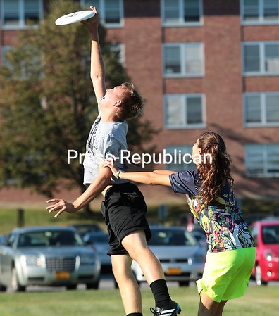 During a recent practice for SUNY Plattsburgh's ultimate Frisbee club team, PFUNK, at the Memorial Hall field, Katie Kuziw shoves Connor Bing out of bounds as he snags a pass, a move that would be illegal in a real match of ultimate Frisbee. The team has been in existence for seven years and travels to tournaments hosted by SUNY schools throughout the state during the fall semester. (GABE DICKENS/P-R PHOTO)