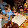 The future celebrates the past as youngsters blow out the candles on two cakes commemorating the 100 years of the Whallonsburg Grange. (ALVIN REINER/P-R PHOTO)