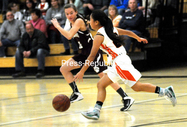 ROB FOUNTAIN/STAFF PHOTO 12-23-2016<br /> Plattsburgh High's Tenzin Pema (23) drives to the frontcourt Tuesday. Northeastern Clinton defeated the Hornets 58-23. Game results were not submitted in time for print, and the box score was incomplete.