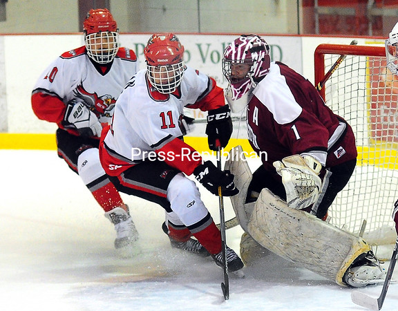 ROB FOUNTAIN/STAFF PHOTO 12-8-2016 Beekmantown's Tyler Baker (10) and Keenan Regan (11) rush the net with Northeastern Clinton goalie Ryan Roberts defending Wednesday during a boys hockey game at Stafford Ice Arena in Plattsburgh.