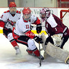 ROB FOUNTAIN/STAFF PHOTO 12-8-2016<br /> Beekmantown's Tyler Baker (10) and Keenan Regan (11) rush the net with Northeastern Clinton goalie Ryan Roberts defending Wednesday during a boys hockey game at Stafford Ice Arena in Plattsburgh.