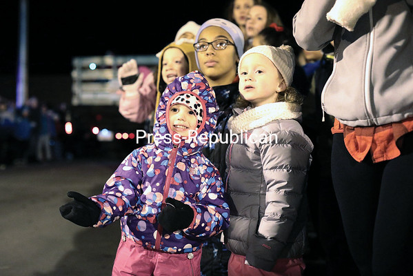 Children gleam with anticipation as float after float make their way through downtown Plattsburgh Saturday. GABE DICKENS/PR PHOTO 12-4-2016