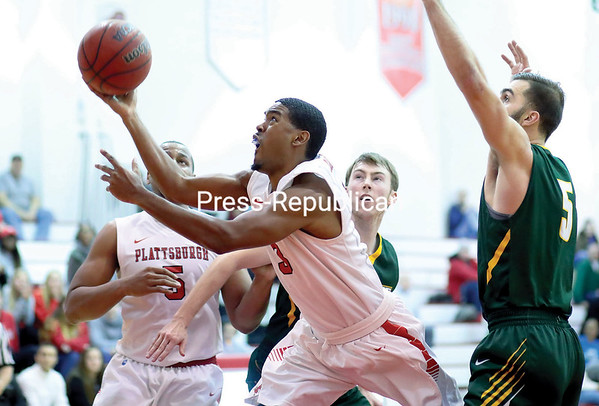 GABE DICKENS/P-R PHOTO 12-7-2016 Plattsburgh State's Eli Bryant throws up a shot in a last-ditch effort, after being fouled by a Skidmore defender, during a non-conference men's basketball game Tuesday at Memorial Hall in Plattsburgh.