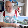 ALVIN REINER/P-R PHOTO 12-7-2016<br /> Bob Carroll of Westport, who was a child living in Hawaii when the Japanese attacked Pearl Harbor, holds a recent photo of the house he lived in there. The banyon tree that he planted as a youngster now dwarfs the home from behind.