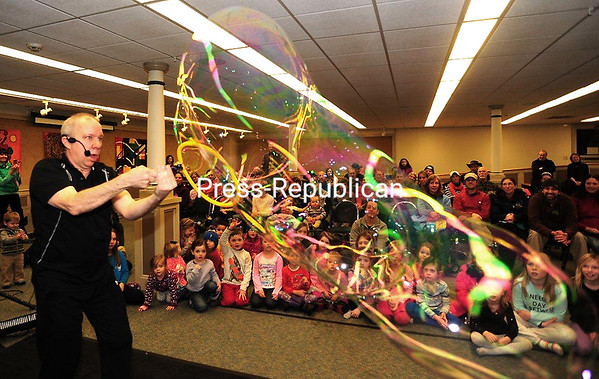 JACK LaDUKE/P-R PHOTO 1-3-2017<br /> Bubble Man Jeff Boyer creates giant, colorful bubbles for a packed house at the Saranac Lake Free Library during the First Night. The village was packed with people enjoying a full night of entertainment to see in the new year.