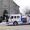ROB FOUNTAIN/STAFF PHOTO 12-28-2016<br /> A Cumberland Head Volunteer Fire Department firetruck leads the motor pool Tuesday for the family of long-time Fire Chief Art Brault to St. John's Church in Plattsburgh for his funeral. Brault, who died last Tuesday, served more than 25 years as chief and worked for 15 years as an employee of the Town of Plattsburgh. Firefighters from around the area attended the funeral and also brought the firetruck for a procession.