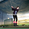 GABE DICKENS/P-R PHOTO 12-31-2017<br /> Olive Kozelian, 16, of Boston, practices her golf swing with her brother, Alex, 15, at the City of Plattsburgh Recreation Center's indoor driving range Friday afternoon. Their family was in town over the holidays visiting relatives, and they all decided to peruse the facility's open gym, where they also played basketball and took part in other activities.