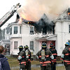 GABE DICKENS/P-R PHOTO 12-30-2017<br /> Members of the Keeseville Fire Department use their aerial ladder truck to knock down the flames shooting through the roof of a home at 30 Broad Lane in AuSable Forks Thursday afternoon. Teenagers Brianna and Chastity Wardell escaped safely, although two cats perished in the fire.