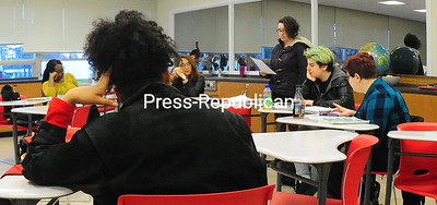SUNY Plattsburgh student Gemma Tendrich practices her pacing while reading a poem as her English 379 classmates listen. Students in the class will read their works at a poetry slam at 30 City in Plattsburgh tonight.   ROB FOUNTAIN/STAFF PHOTO 12-8-2016
