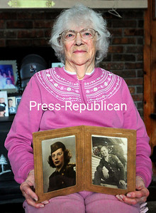 ROB FOUNTAIN/STAFF PHOTO 12-7-2016 Morrisonville resident Dorothy Cayea LeClair holds photos of herself and her husband, Carl LeClair, when they were in World War II. LeClair was a nursing student at Watertown's Mercy Hospital in 1941 when Pearl Harbor was bombed.