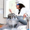 "GABE DICKENS/P-R PHOTO 4-13-2016<br /> Dr. Linda Luck, a professor of chemistry at SUNY Plattsburgh, creates ice cream in under two minutes by adding liquid nitrogen to the raw ingredients in the mixer during her recent presentation, ""Molecular Gastronomy: From Paris to Plattsburgh,"" at the Champlain Wine Company in Plattsburgh. Luck spent time in Paris working alongside Hervé This, an internationally-renowned French physical chemist and cook, at AgroParisTech studying molecular gastronomy, which seeks an understanding of the physical and chemical transformations of ingredients in cooking."