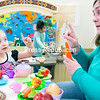 GABE DICKENS/P-R PHOTO 4-13-2016<br /> Myla Rivers, 3, shows her grandmother Elaine LaVarnway that she is allowed only one carrot to go along with her tea, while Myla's cousin Zcarina, 4, cooks in the kitchen during the family's recent visit to the Kids Station Children's Museum located at 13 New York Road In Plattsburgh. The museum is open seven days a week, and the cost is $5 per person. For more information, visit kidsstationplattsburgh.org or call 324-7426.