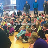 MAGGIE McVEY/STAFF PHOTO  4-28-2016<br /> Children stretch in Plattsburgh City Gym before heading outside for a recent Clinton County Youth Bureau Fun Run. Distances for the event are geared for different age groups — those 6 and younger tackle a quarter mile, kids ages 7 through 10 run a half mile, and ages11 through 14 take on a full mile.
