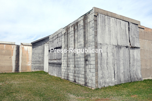 Loose plywood sheets cover a section of the back outside wall of Whispering Maples Mausoleum in the Town of Plattsburgh, demonstrating the deterioration of the building, which was never fully completed after initial construction. That facility and a mausoleum and crematorium in the Town of Ellenburg are functioning now under a receivership but will ultimately become the responsibility of the towns where they sit. A meeting set for 6 p.m. Wednesday, April 27, at the Plattsburgh Town Hall will bring the public up to date on the issue. <br /> ROB FOUNTAIN/STAFF PHOTO  4-26-2016