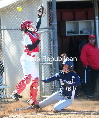 ROB FOUNTAIN/STAFF PHOTO  4-26-2016<br /> Plattsburgh catcher Jennifer Sarcone (19) goes up for the ball with Middlebury's Kat Maehr (16) slide in safely Wednesday during women's softball in Plattsburgh.